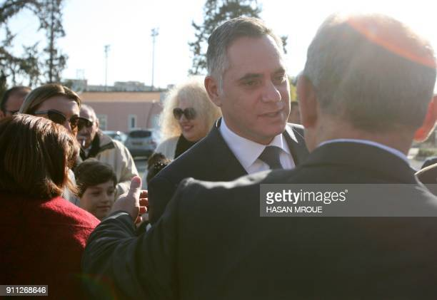 Nikolas Papadopoulos a former president's son and candidate in the 2018 Cypriot presidential election is greeted by officials and supporters upon his...