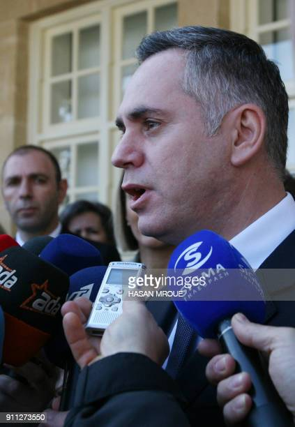 Nikolas Papadopoulos the son of a former president of Cyprus and candidate in the 2018 presidential election talks to the media after casting his...