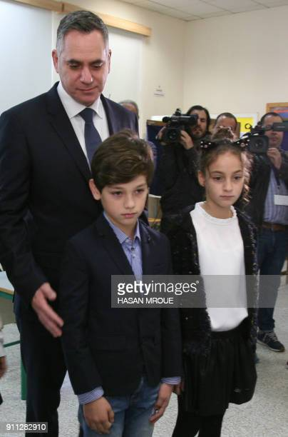 Nikolas Papadopoulos the son of a former president of Cyprus and candidate in the 2018 presidential election stands with his son Tassos and daughter...