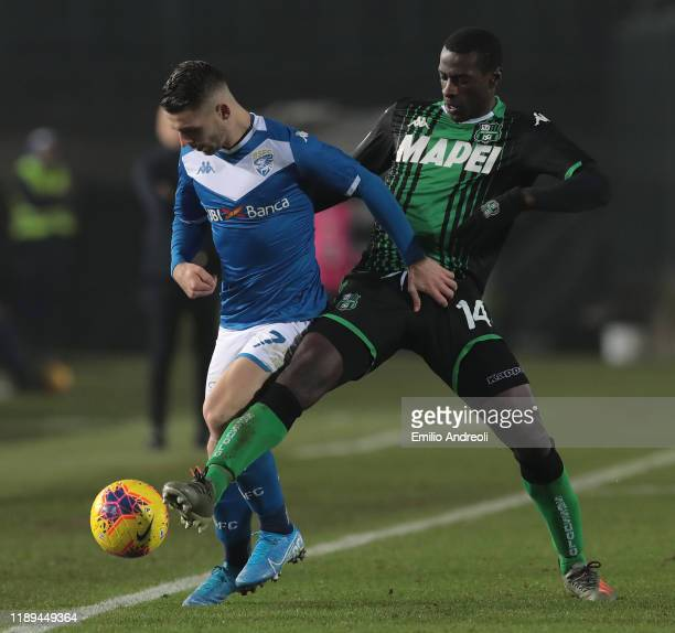 Nikolas Spalek of Brescia Calcio is challenged by Pedro Obiang of US Sassuolo during the Serie A match between Brescia Calcio and US Sassuolo at...