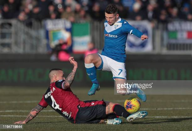 Nikolas Spalek of Brescia Calcio is challenged by Radja Nainggolan of Cagliari Calcio during the Serie A match between Brescia Calcio and Cagliari...