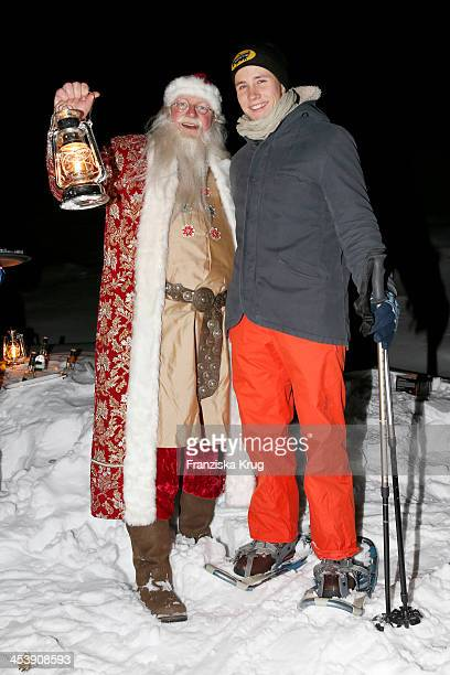Nikolaus and Luca Bettermann attend the Snowshoe Hiking And Slide Tour - Tirol Cross Mountain 2013 on December 05, 2013 in Innsbruck, Austria.