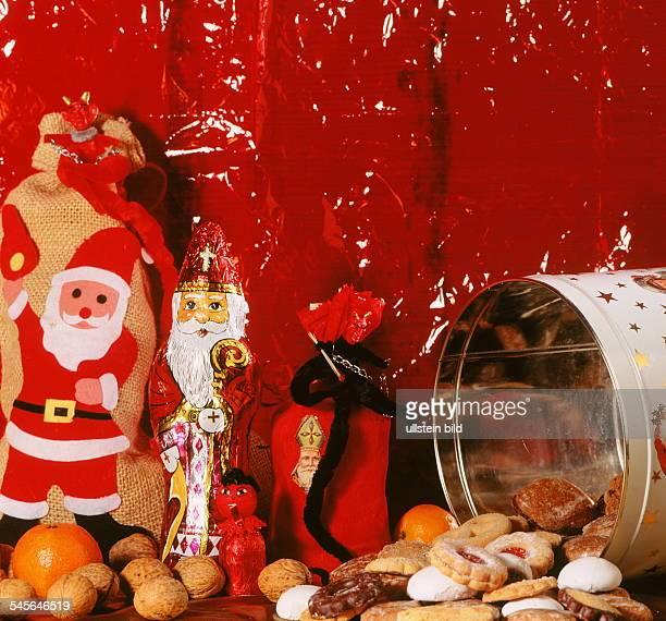 Nikolaus aus Schokolade Dose mit Keksen Walnüsse und Geschenke 1998