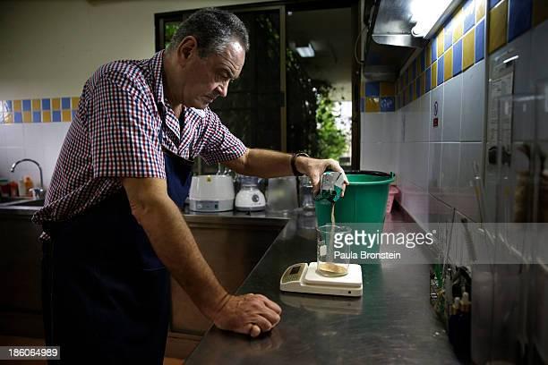 Nikolaus Prachensky measures the yeast in his lab at the Niikki Pure Spirits distillery on October 24 2013 in Mae Rim Thailand Austrian Entrepreneur...