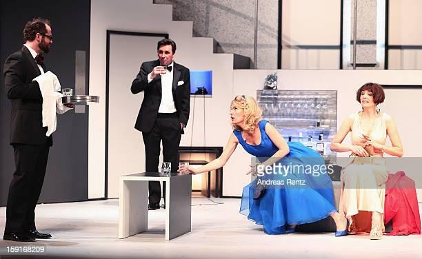 Nikolaus Szentmiklosi Ivan Vrgoc Maria Furtwaengler and Nicole Marischka perform during the 'GeruechteGeruechte' photo rehearsal at Komoedie am...