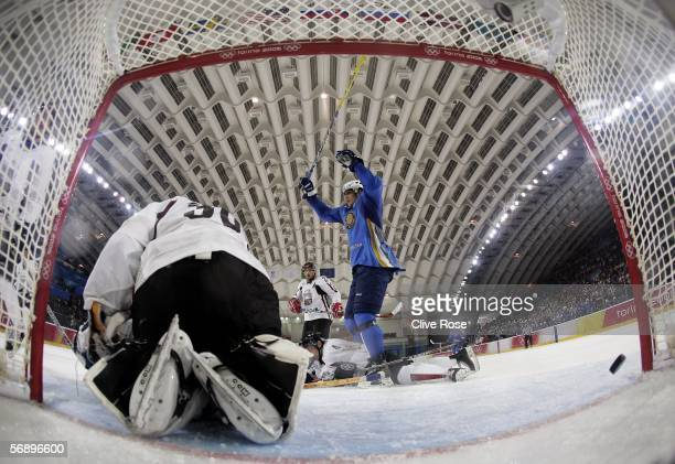 Nikolay Antropov of Kazakhstan scores a goal in the second period during the men's ice hockey Preliminary Round Group B match between Latvia v...