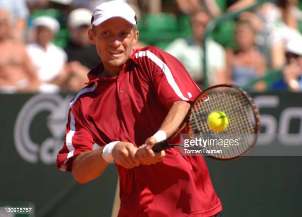 Nikolay Davydenko hits a return to Tommy Robredo in the finals of the 2006 Swedish Open in Båstad, Sweden, July 16, 2006. Robredo won 6-2, 6-1.