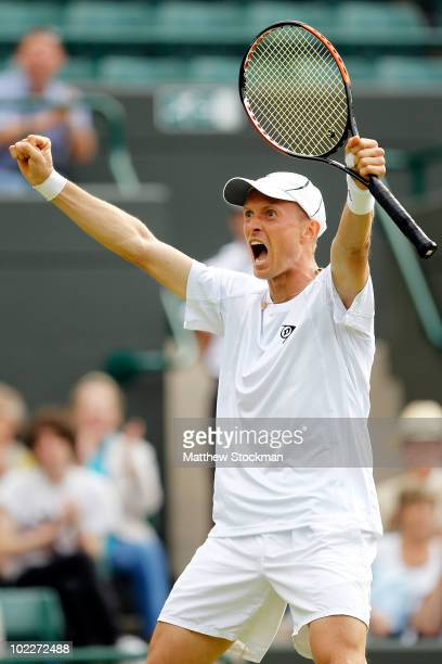 Nikolay Davydenko of Russia celebrates match point during his first round match against Kevin Anderson of South Africa on Day One of the Wimbledon...