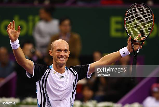 Nikolay Davydenko of Russia celebrates victory over Rafael Nadal of Spain during the Final match of the ATP Qatar ExxonMobil Open at the Khalifa...