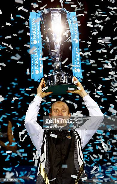 Nikolay Davydenko of Russia holds the trophy as he celebrates winning the men's singles final match against Juan Martin Del Potro of Argentina during...