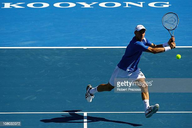 Nikolay Davydenko of Russia plays a backhand during his match against Lleyton Hewitt of Australia during day three of the AAMI Classic at Kooyong on...