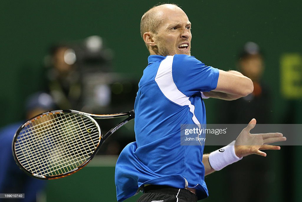 Nikolay Davydenko of Russia plays a forehand during the final against Richard Gasquet of France on day six of the Qatar Open 2013 at the Khalifa International Tennis and Squash Complex on January 5, 2013 in Doha, Qatar.