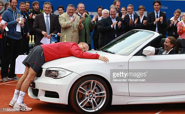 Nikolay Davydenko of Russia poses with his winners present, the BMW 1 convertible at the winners presentation after his final match against Florian...