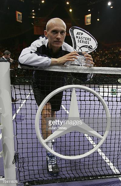 Nikolay Davydenko of Russia poses with the ATP Masters Series trophy after defeating Dominik Hrbaty of Slovakia in the final during day seven of the...