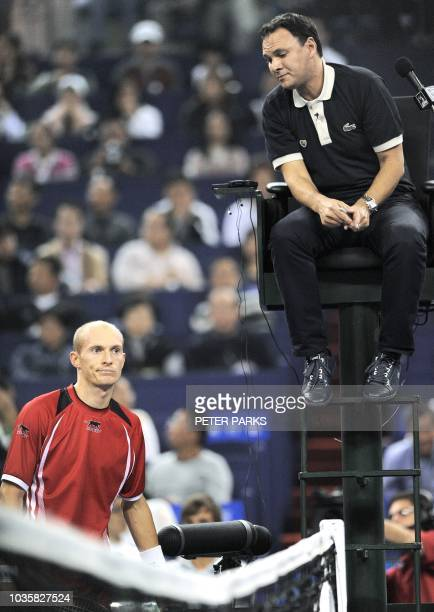 Nikolay Davydenko of Russia reacts after discussing a line call with chair umpire Mohamed Lahyani while playing against Novak Djokovic of Serbia in...