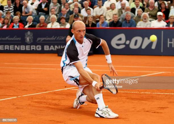 Nikolay Davydenko of Russia returns the ball during the match against Victor Hanescu of Romania during day five of the International German Open at...