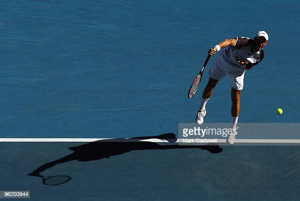 Nikolay Davydenko of Russia serves in his quarterfinal match against Roger Federer of Switzerland during day ten of the 2010 Australian Open at...