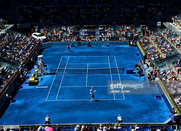 Nikolay Davydenko of Russia serves the ball to Rafael Nadal of Spain during the Mutua Madrilena Madrid Open tennis tournament at the Caja Magica on...