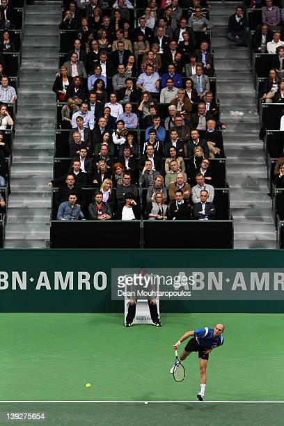 Nikolay Davydenko of Russia serves to Roger Federer of Switzerland in the semi final on day 6 of the ABN AMRO World Tennis Tournament on February 18...