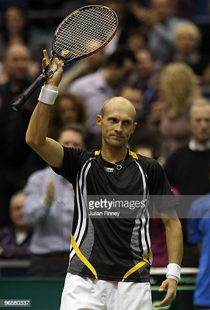 Nikolay Davydenko of Russia thanks the support after defeating Marcus Baghdatis of Cyprus during day four of the ABN AMBRO World Tennis Tournament on...