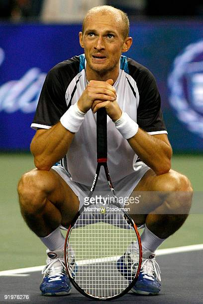 Nikolay Davydenko of Russia watches the instant replay board for determination of match point against Rafael Nadal of Spain after their match during...