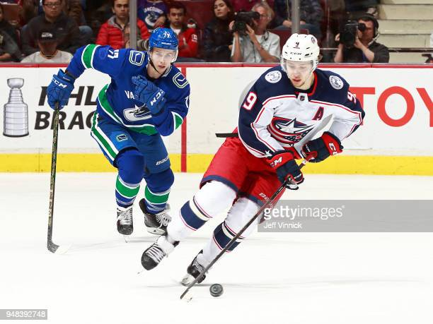 Nikolay Goldobin of the Vancouver Canucks looks on as Artemi Panarin of the Columbus Blue Jackets skates up ice with the puck during their NHL game...
