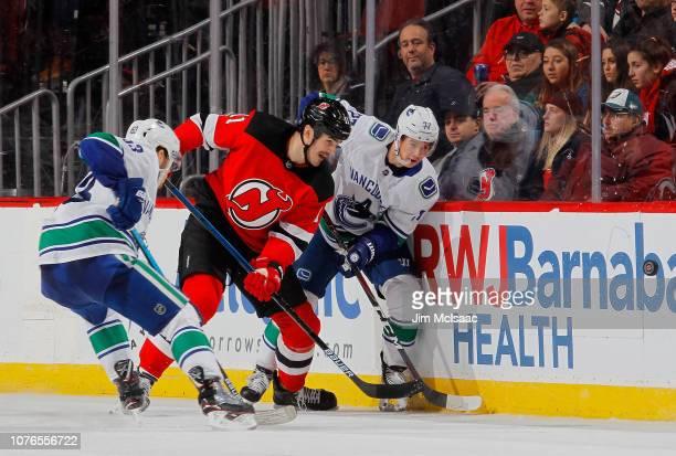 Nikolay Goldobin skates against Brian Boyle of the New Jersey Devils at  Prudential Center on December 8fca82feb