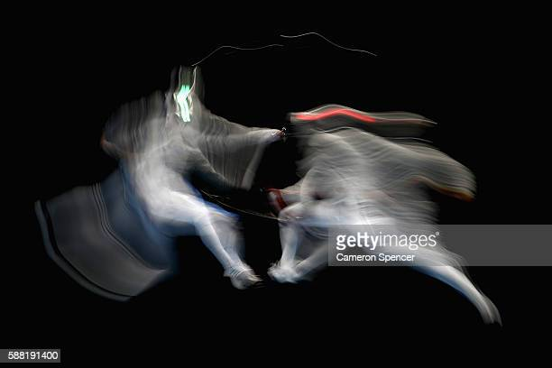 Nikolay Kovalev of Russia and Aldo Montano of Italy compete during the men's individual sabre on Day 5 of the Rio 2016 Olympic Games at Carioca Arena...
