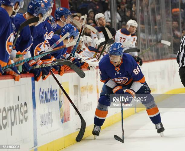 Nikolay Kulemin of the New York Islanders is injured on a second period check by Eric Gryba of the Edmonton Oilers at the Barclays Center on November...