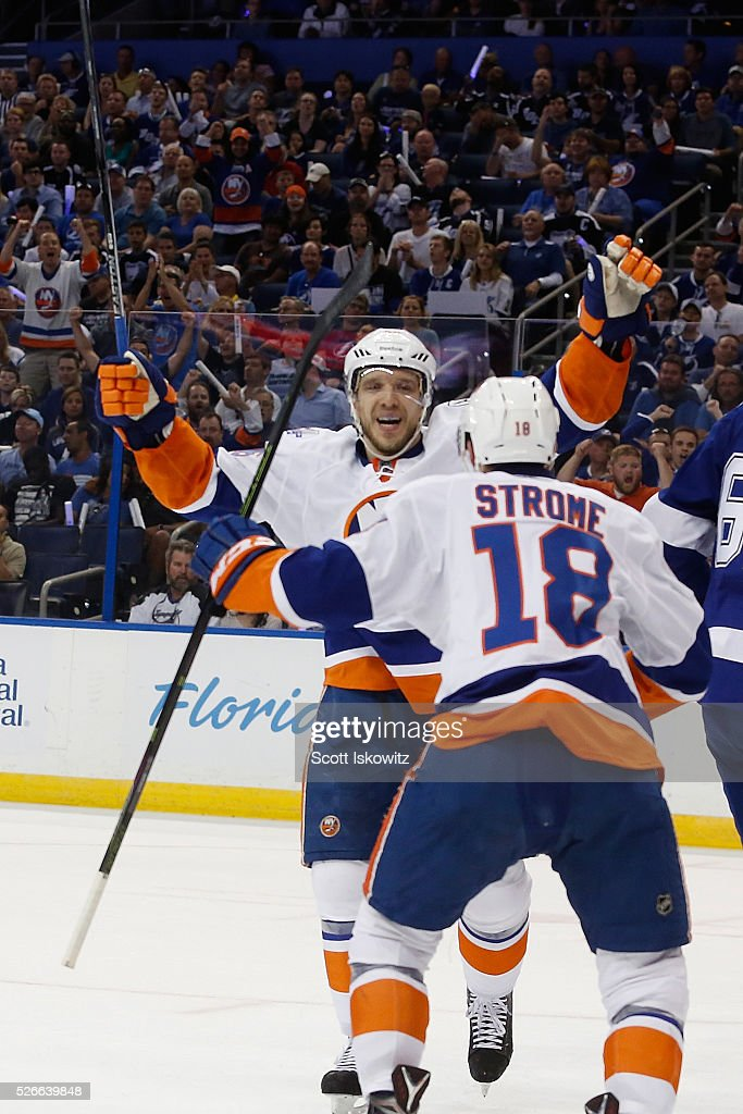 Nikolay Kulemin #86 of the New York Islanders reacts after scoring a goal with teammate Ryan Strome #18 of the New York Islanders during the first period in Game Two of the Eastern Conference Second Round during the 2016 NHL Stanley Cup Playoffs at Amalie Arena on April 30, 2016 in Tampa, Florida.