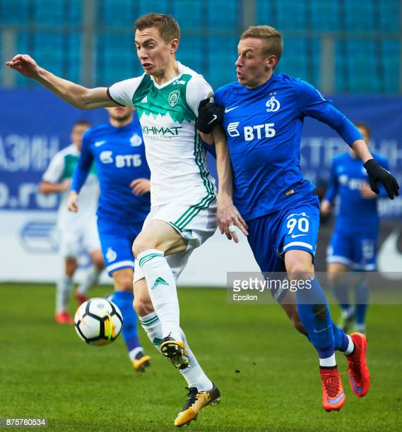 Nikolay Obolskiy of FC Dinamo Moscow vies for the ball with Andrei Semyonov of FC Akhmat Grozny during the Russian Premier League match between FC...