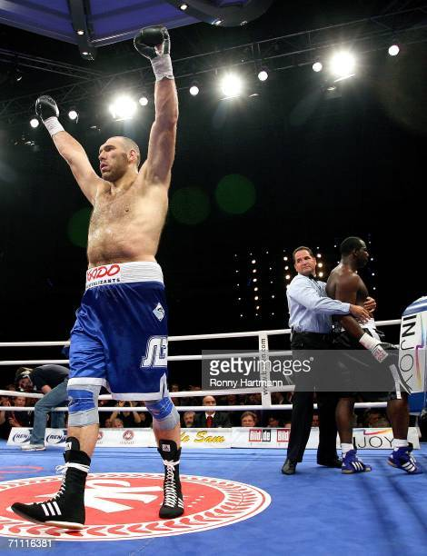 Nikolay Valuev of Russia celebrates after winning the WBA World Heavyweight Championship against Owen Beck of Jamaica at the Tui Arena on June 3 2006...