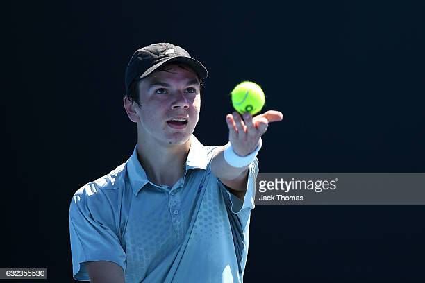 Nikolay Vylegzhanin of Russia competes against Duarte Vale of Portugal during the Australian Open 2017 Junior Championships at Melbourne Park on...