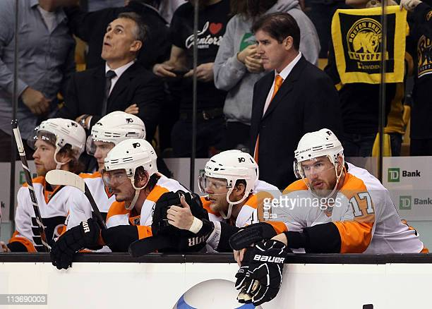 Nikolay Zherdev Kris Versteeg and Jeff Carter of the Philadelphia Flyers look on late in the third period against the Boston Bruins in Game Three of...