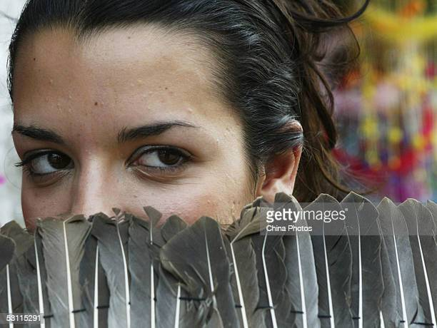 Nikoletta Ralli from Greece poses for pictures with a goose feather fan during a sightseeing activity of 2005 Miss Tourism Queen International...