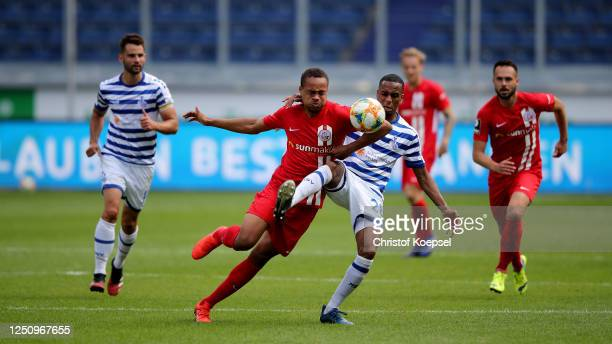 Nikolkas Nartey of Rostock challenges Yassin Ben Balla of Duisburg during the 3. Liga match between MSV Duisburg and Hansa Rostock at...
