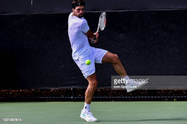 Nikoloz Basilashvili hits a volley against Matteo Berrettini during the WinstonSalem Open on August 21 2018 at the Wake Forest Tennis Center in...