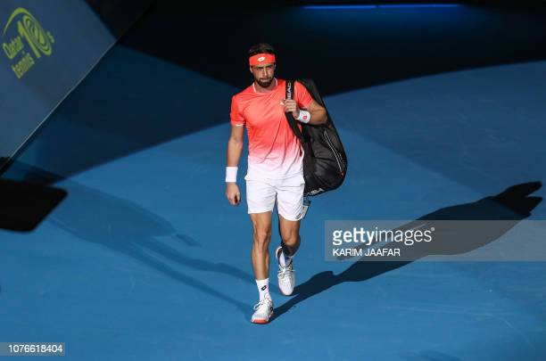 Nikoloz Basilashvili of Georgia arrives for his ATP Qatar Open tennis quarterfinal match against Novak Djokovic of Serbia in Doha on January 3 2019