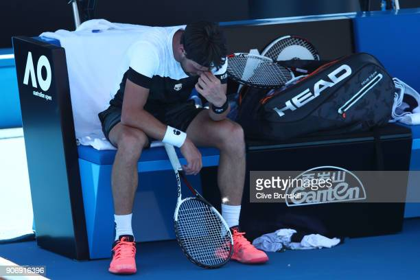 Nikoloz Basilashvili of Georgia attempts to cool down after losing his third round match against Kyle Edmund of Great Britain on day five of the 2018...