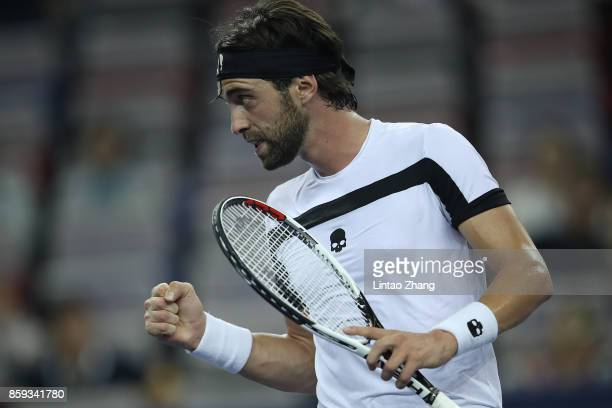 Nikoloz Basilashvili of Georgia celebrates a point against during the Men's singles mach against Juan Martin del Potro of Argentina on day two of...