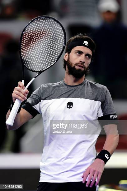 Nikoloz Basilashvili of Georgia celebrates after defeating Kyle Edmund of Great Britain during his Men's Singles Semifinals match in the 2018 China...