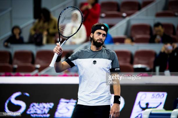 Nikoloz Basilashvili of Georgia celebrates after win against Kyle Edmund of Great Britain during his Men's Singles Semifinals match in the 2018 China...