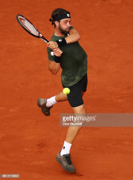 Nikoloz Basilashvili of Georgia hits a backhand during the men's singles third round match against Rafael Nadal of Spain on day six of the 2017...