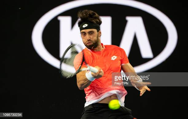 Nikoloz Basilashvili of Georgia hits a forehand to Stefanos Tsitsipas of Greece during day five of the 2019 Australian Open at Melbourne Park on...