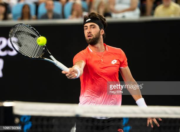 Nikoloz Basilashvili of Georgia hits a forehand volley to Stefanos Tsitsipas of Greece during day five of the 2019 Australian Open at Melbourne Park...