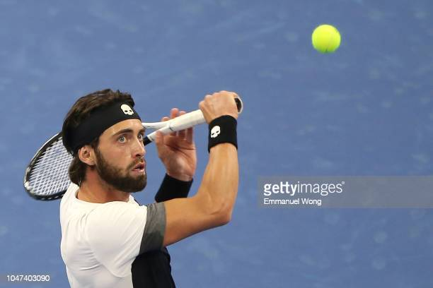 Nikoloz Basilashvili of Georgia hits a return against Juan Martin Del Potro of Argentina during his Men's Singles Finals match in the 2018 China Open...