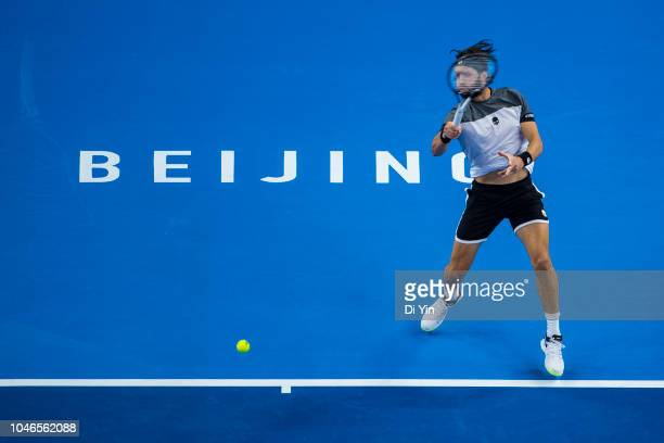 Nikoloz Basilashvili of Georgia hits a return against Kyle Edmund of Great Britain during his Men's Singles Semifinals match in the 2018 China Open...