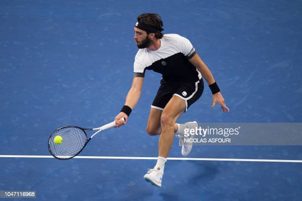 Nikoloz Basilashvili of Georgia hits a return during his men's final match against Juan Martin Del Potro of Argentina at the China Open tennis...