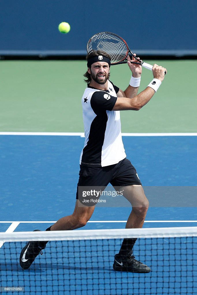 Nikoloz Basilashvili of Georgia hits a return to David Goffin of Belgium during the first round of play on Day 4 of the Western & Southern Open at the Lindner Family Tennis Center on August 16, 2016 in Mason, Ohio.