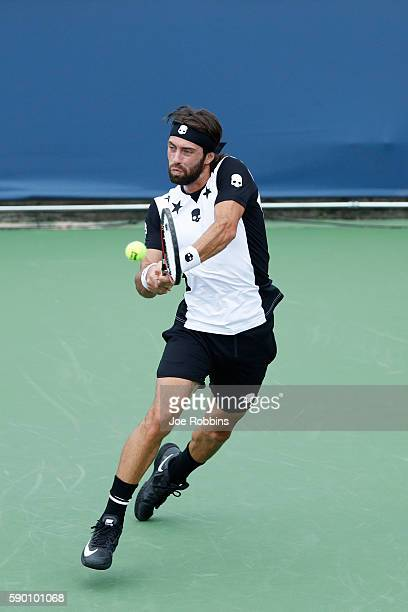 Nikoloz Basilashvili of Georgia hits a return to David Goffin of Belgium during the first round of play on Day 4 of the Western Southern Open at the...